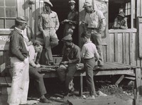 Migratory Workers Playing Checkers in Front of a Juke Joint During the Slack Season for Vegetable Pickers, Belle Glade, Florida, Marion Post Wolcott, gelatin silver print