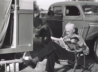 Reading Magazine Behind His Trailer Home, Sarasota, FL, Marion Post Wolcott, gelatin silver print