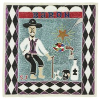 """Flag depicts bearded man wearing black hat and holding cane. One pant leg is rolled up. Objects on the ground include crossed bones, skull, and bottle. To the man's right is a star with rays of light, a rattle, and a candle. Background has pale blue sequins and border has black, purple, and white diamonds, triangles, and half-circles. Figure represents """"loa"""" Baron Samedi, but rolled up pant leg is typically a reference to Azaka, or Papa Zaka."""