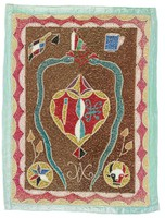 """Flag bears two green snakes, """"veve"""" of Damballah. They flank a stylized heart referring to Erzulie Freda. Other symbols are the asson and cup, star, and bull's head which represents the """"loa"""" Bossou."""