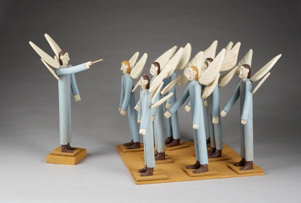 Eight blue angels with upturned wings and director angel holding baton, with flat base for group and block base for director.