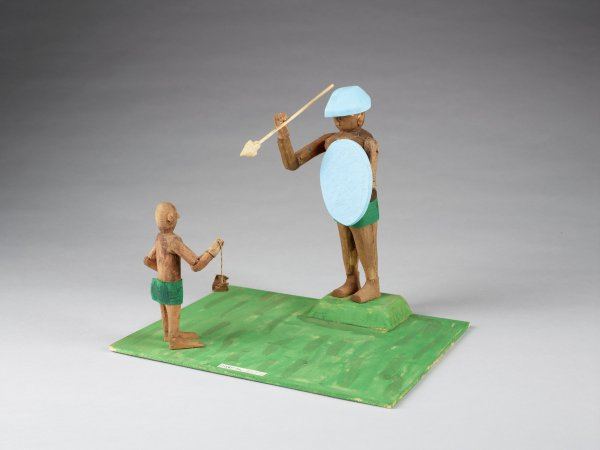 Daniel holding sling facing Goliath holding spear and blue shield.