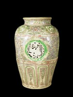 Large polychrome jar with openwork bisque fired panels depicting cranes amidst clouds, painted designs in underglaze-blue of winged horse, a ky lan, a tiger-like creature with a Chinese coin, lotus and lotus panels