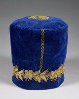Blue velvet man's kufi-style hat embellished with gold thread