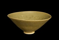 Bowl with carved vegetal decoration.