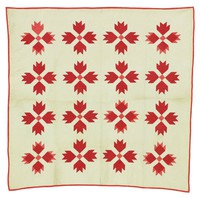 Bear's Paw quilt, red on white, found in Tuscaloosa, Alabama