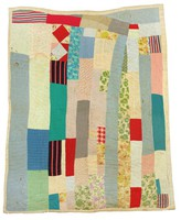 Strip quilt with Red Lion 100 pound wheat cotton sack backing.