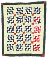 "Endless stairs quilt. Light colored fabric on lower left has printed, "" Enterprise AL"""