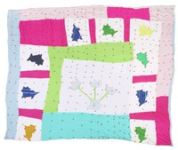 White background quilt with several cats and a pot of flowers.