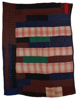 Strip quilt in browns, blues, and plaids.