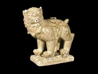 Water dropper in the shape of a caparisoned lion with carved lotus petal base.