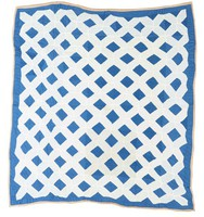Leaping frog quilt in blue and white.