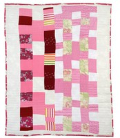 Pink and white blocks quilt.