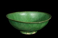 Bowl with molded floral designs, lead-green glaze.
