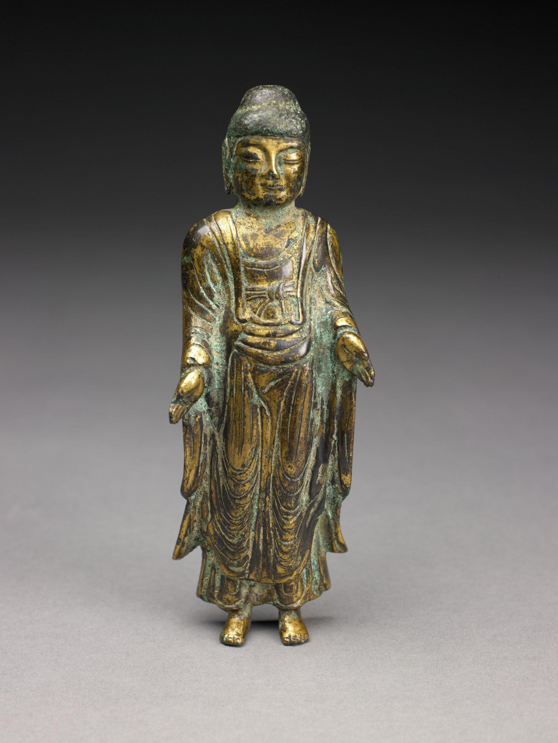 Standing image of Buddha, base missing