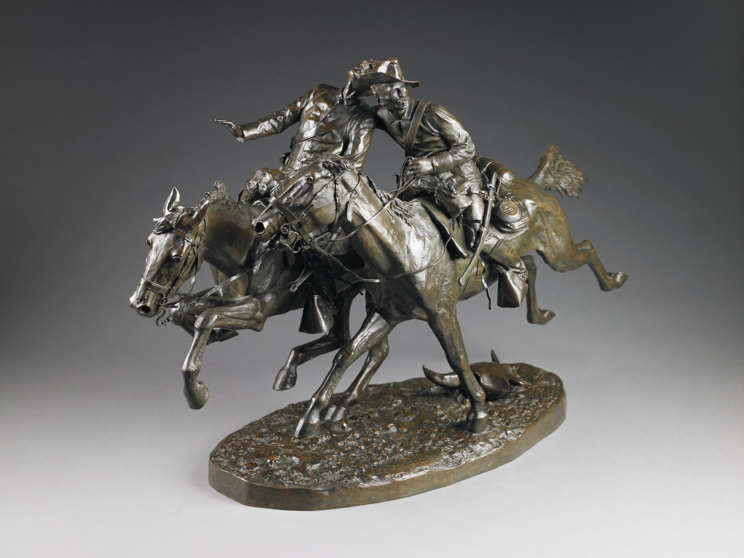 Two cavalry soldiers riding at full gallop. One has been founded and the other is helping to support him. The figures are supported solely by the foreleg of one horse and the hind leg of the other. A single buffalo skull adorns the base.