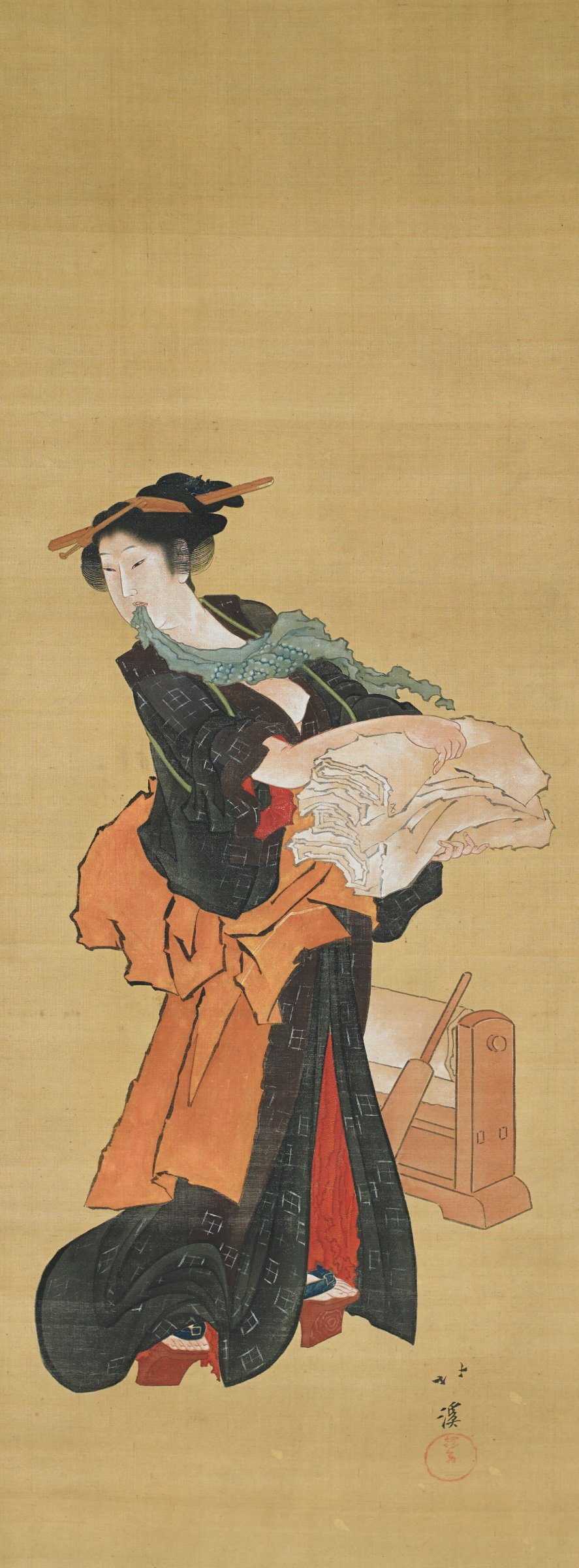 Painting of a young woman in a black summer kimono with one breast exposed, holding a bolt of white cloth. She stands in front of a beater and roller for fulling cloth. Brick and olive brocade mounting with ivory roller ends