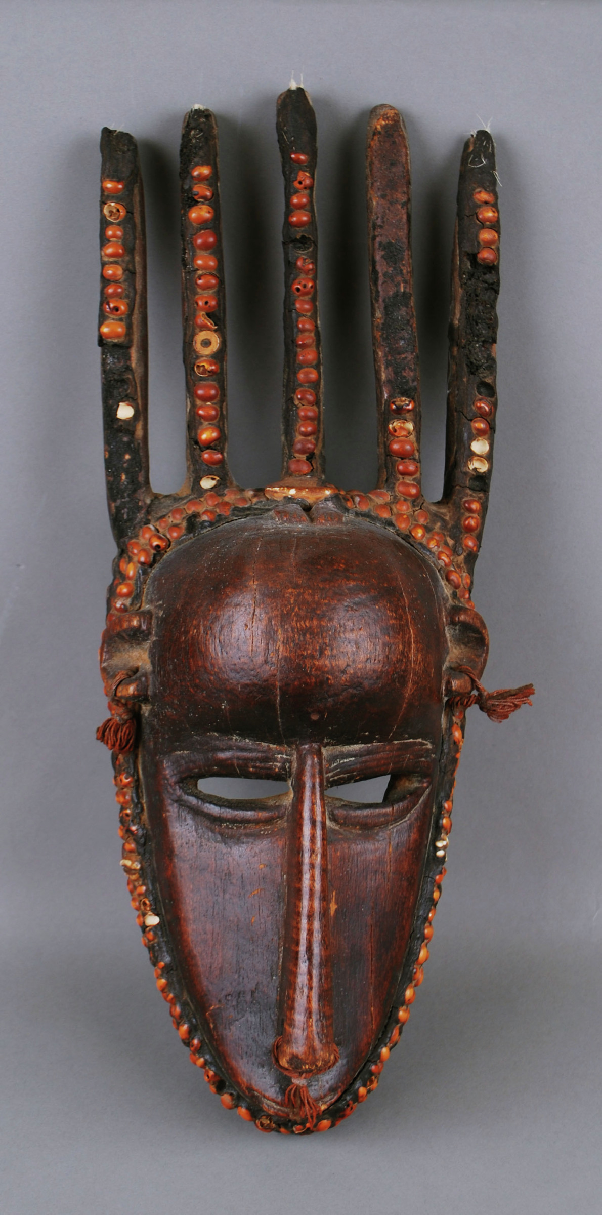 Mask (ntomo), Bamana people, Mali, African, wood, horn, pitch, seed, cowrie shell