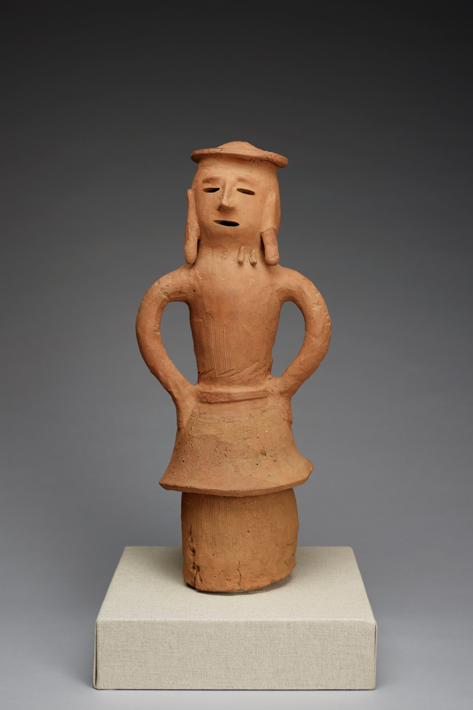 A standing earthenware Haniwa burial figure