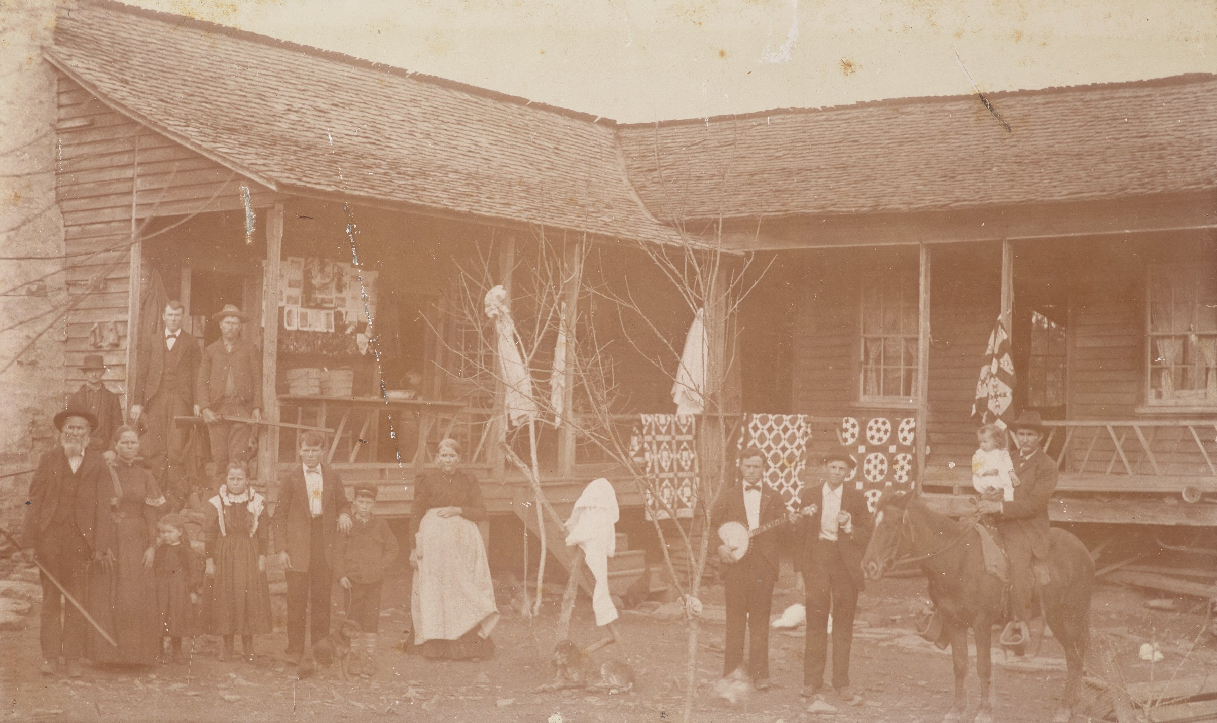Photograph of the William Mabrey Thomas family, with Mary Ann Rouse Thomas wearing an apron, Nyota, Blount County, Alabama, 1899