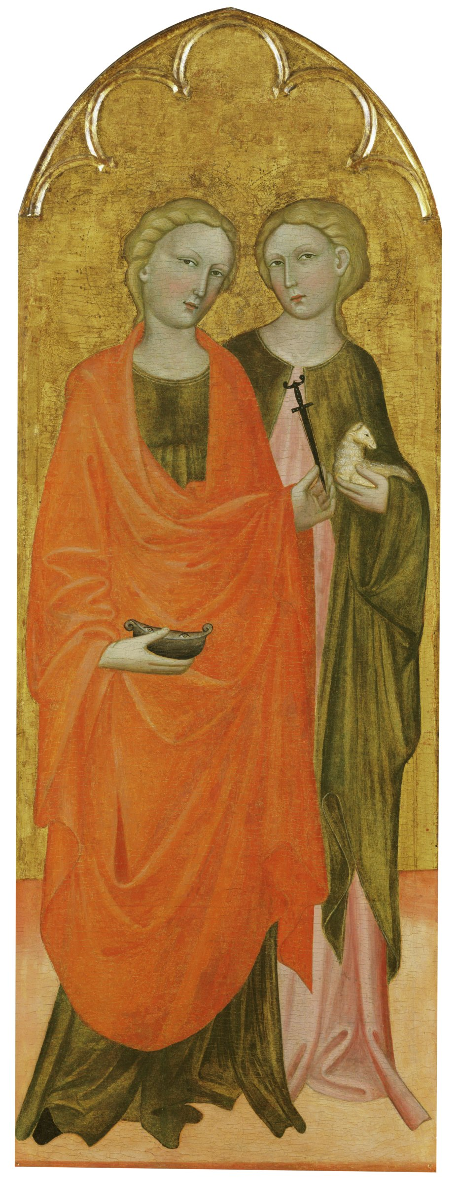 """Saint Lucy stands holding a dagger in her left hand, a symbol of her martyrdom, and in her right she holds a bowl with her two eyes. According to legend, she plucked out her eyes but they were miraculously restored. Agnes stands behind her, holding a lamb, a reference to her name, which means """"lamb"""" in Latin."""