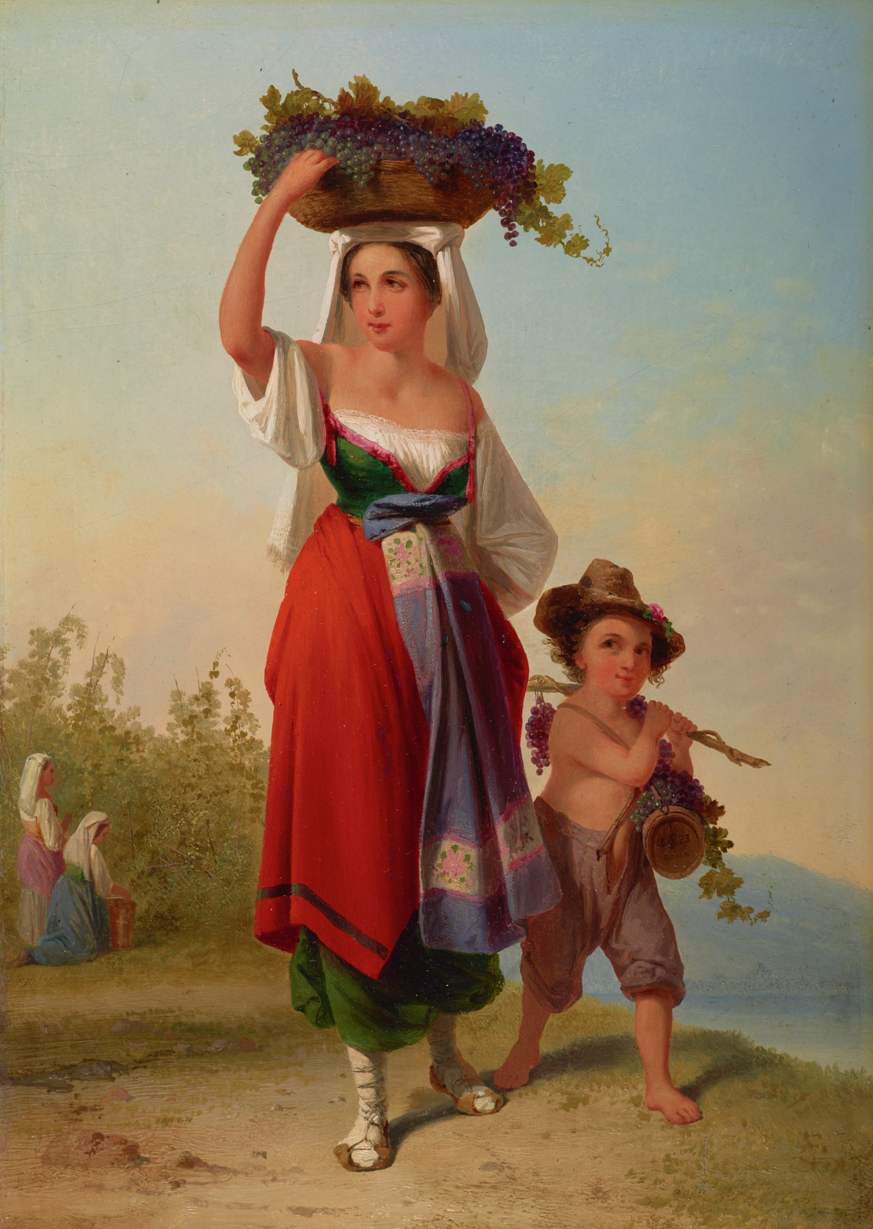 """At left, a woman in traditional """"ciociara"""" peasant costume, carries a basket of grapes atop her head. A boy, at right, perhaps the young son of the woman, holds a small cask under his proper left arm. Over his proper left shoulder, the boy carries a branch laden with grapes, steadied with his proper right hand. In the background at left, two women can be seen harvesting grapes."""