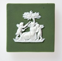 Square dark green jasper plaque with white relief of Psyche wounded and bound by Cupids.