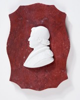 Rectangular scalloped edge marble(?) plaque with white relief profile portrait of a man, relief separated from backing and is broken in two pieces