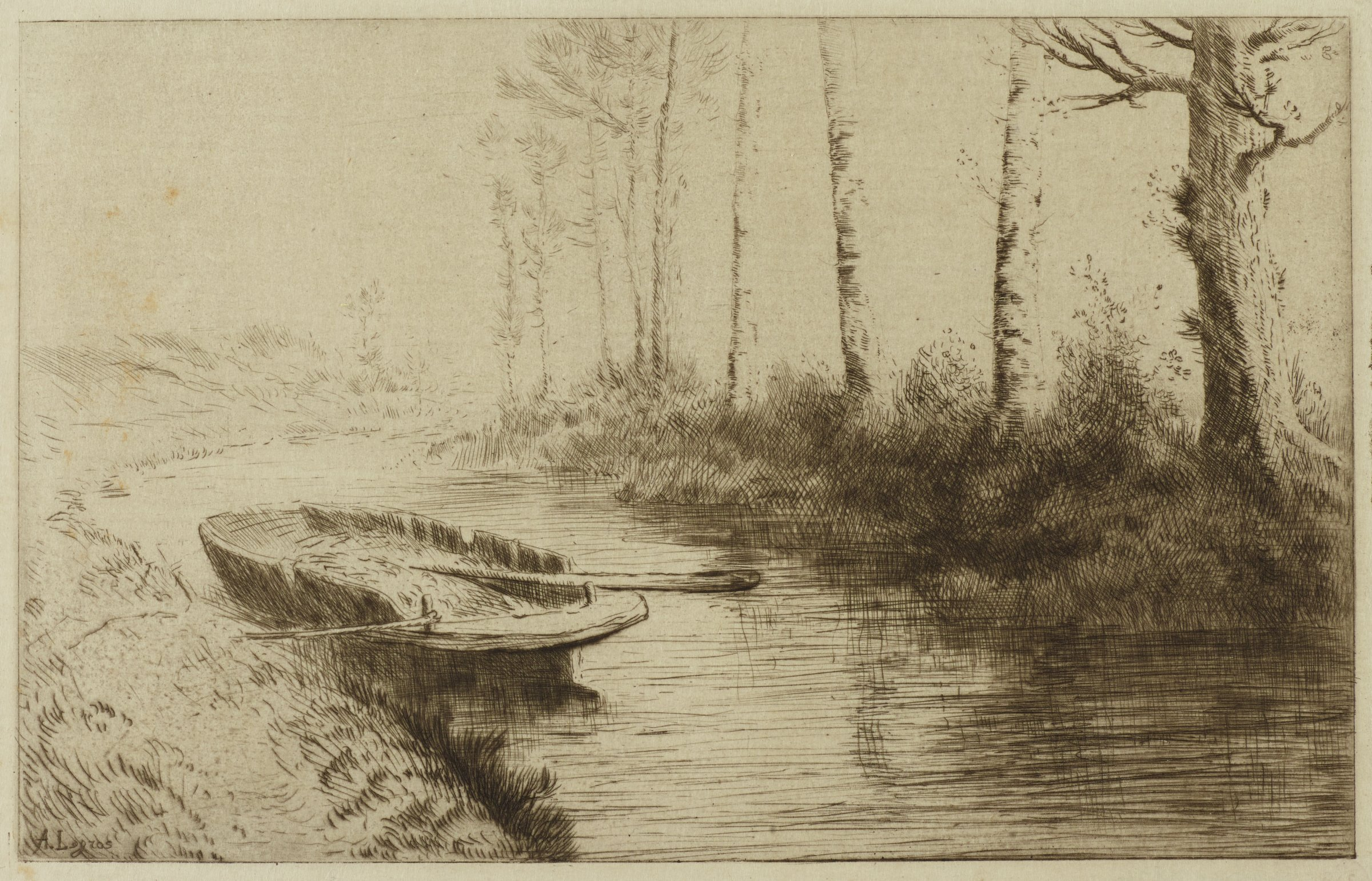 An empty canoe is tied to the bank of a canal. A row of trees populate the opposite bank.
