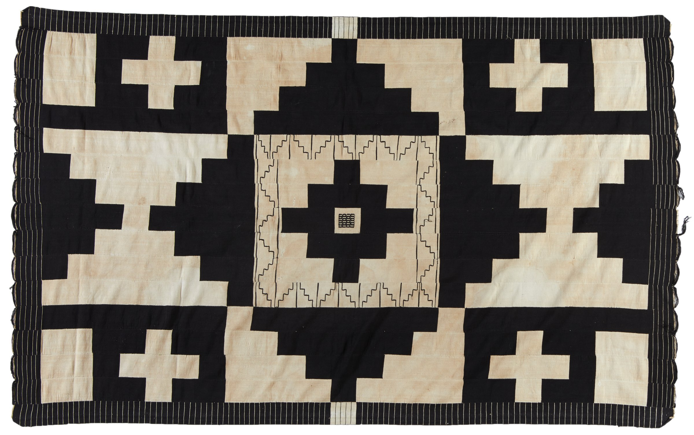 Black and white blanket, strip-woven with stepped design, made by Vasili or Vassili, master weaver?
