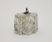 Silver tea canister with flat hinged lid, the finial in the form of a leaf and berry or nut, the body of scalloped shaped and heavily decorated with representations of pagodas, palm trees, fountains and Chinese figures, on the front in a small reserve are engraved the initials FWP.
