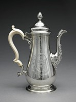 Tall, elongated, pear-shaped silver coffeepot on round, molded foot with double C-scroll ivory handle and hinged, double-domed lid with pinecone finial, the curved spout with applied shell-like motifs, on one side of the main body in bright-cut engraving within an oval reserve comprised of leafy motifs a coat of arms (possibly of the Irish branch of the Judge family) hanging from a tied ribbon, outside the reserve two bound branches (one laurel, one possibly palm), above a badge with a seated Irish Wolfhound.