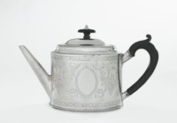 Silver teapot of oval form with beaded lower edge, the spout long and straight with small shoulder and short neck, the hinged, domed lid with beaded edge and wooden, mushroom knop with silver ball finial, the ear-shaped handle with curved thumb rest also wood, the main body heavily decorated with bright-cut engraved bands of stylized floral motifs at top and bottom and in the middle floral garlands and scrolls, on either side an empty oval reserve.
