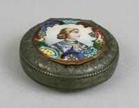 Enamel miniature portrait of a man on top.