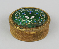 Oval box with green enamel lid.