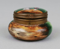 Round box with lid decorated with a man and woman.