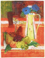 A yellow, pink, and green vase holds blue flowers. Beside the vase is a pile of various fruits, a bottle, and goblet.