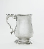 Simple, plain silver mug of baluster shape with stepped, flared foot, the double C-scroll handle with acanthus accent.