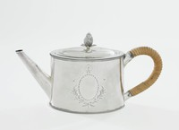 Small, simple teapot of oval shape with beading around the bottom and upper edges, with plain, straight spout and loop handle that is encased in wicker, the hinged, flat cover with pineapple knop, the main body engraved on both sides with oval reserves (left empty) above two crossed and bound leafy sprigs and below a ribbon.