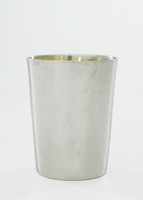 Very simple small silver beaker of tapered cylindrical form, the main body left undecorated, the interior with a light gold wash.