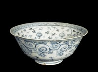 Bowl with double-vajra painted in the well, surrounded by meandering lotus flowers, leaves and crosshatch pattern around rim. The exterior has two mythical beasts cavorting amidst scrolling lotus flowers and ferns. All are painted in underglaze cobalt blue oxide.