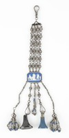 """Chatelaine comprised of a hook at the top from which extend four chains comprised of small, faceted, cut-steel beads set in beaded, cut-steel mounts between simple round links, these are attached to an octagonal, two-sided medallion of white jasper with dark blue jasper dip and white jasper bas relief of on one side """"Priam begging the body of Hector"""" – Priam, King of Troy, begging Achilles for the body of his son Hector – and on the other """"Choice of Hercules"""" in a beaded, cut-steel mount, from the medallion extend five chains, the two outer of which are made of simple faceted, cut-steel beads with tassels at the ends, the two inner of small, faceted, cut-steel beads set in beaded, cut-steel mounts between simple round links and with hooks at the ends, the center chain is shorter and comprised of small, faceted, cut-steel beads ending in a loop, a black basalt seal, or signet (accession number 1977.161) and a blue and white jasper seal, or signet (accession number 1977.160) are attached to the two hooks."""