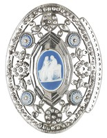 Oval buckle comprised of a laminated dark blue and white jasper medallion with white jasper bas relief of two seated classical female figures set in pierced and beaded cut-steel mount adorned with four laminated dark blue and white jasper rosettes with steel bead centers.