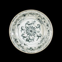 Dish with chrysanthemum in center surrounded by scrolling clouds, floral scrolling above and scroll pattern on rim, all painted in underglaze cobalt blue oxide