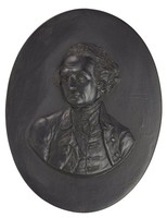 Oval portrait medallion in black basalt depicting Captain James Cook (1728-1779) facing front, his head slightly left, wearing civilian dress.