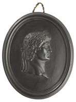 Oval medallion of black basalt with the bas relief portrait bust  of Roman Emperor Augustus (63 BC-14 AD) facing right, wearing laurel leaf crown, self frame, pierced to hang.