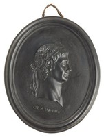 Oval medallion of black basalt with the bas relief portrait bust of Roman Emperor Claudius (11 BC-54 AD) facing right, wearing laurel leaf crown, the name CLAUDIUS impressed below the truncation, self frame, pierced to hang.