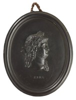Oval medallion of black basalt with the bas relief portrait bust of Roman Emperor Nero (37-68 AD) facing right, wearing laurel leaf crown, the name NERO impressed below the truncation, self frame, pierced to hang.