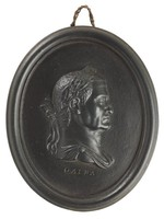 Oval medallion of black basalt with bas relief portrait bust of Roman Emperor Galba (3 BC-69 AD) facing right, wearing laurel leaf crown, the name GALBA impressed below the truncation, self frame, pierced to hang.
