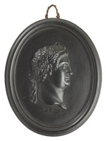 Oval medallion of black basalt with the bas relief portrait bust of Roman Emperor Otho (32-69 AD) facing right, wearing laurel leaf crown, the name OTHO impressed below the truncation, self frame, pierced to hang.